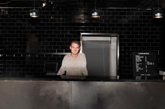 """""""Vi har renoverat sedan maj så jag ser fram emot invigningen"""" säger Martin Brandt, kurator på Malmö nation, ståendes i nationens nya bar. Foto: Fanny Beckman."""